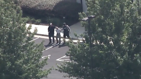 Man escorted in handcuffs from Pittsboro credit union after standoff