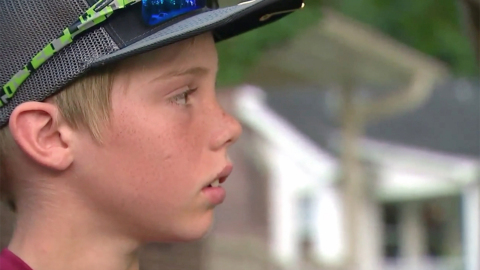 'I hit him in the back with this machete': Boy to 911 operator
