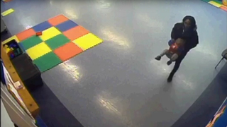 Day care surveillance video shows interaction of teacher and child