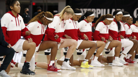 NC State players kneel during national anthem