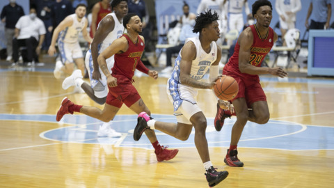 UNC battles Louisville in ACC college basketball action