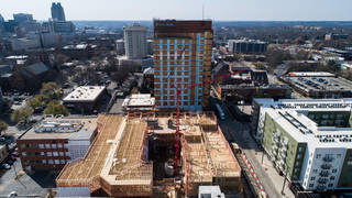 Metropolitan apartment building rises from the ashes