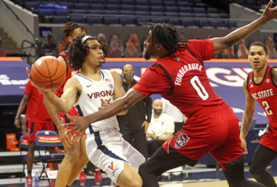 NC State battles Virginia in ACC basketball action