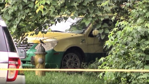 Police investigating homicide after body found in taxi