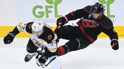 Bruins score four goals in third period for 4-3 win over Canes