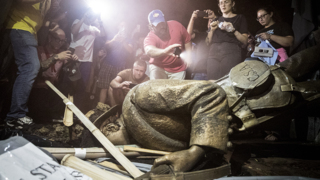 Protest in North Carolina ends with the fall of Confederate statue 'Silent Sam'