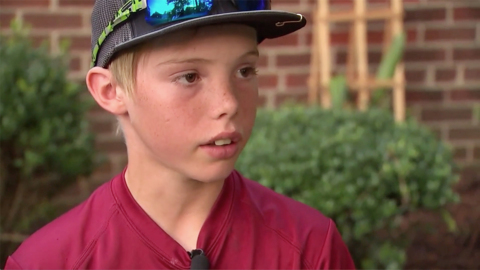 11-year-old boy uses machete to stop home invader