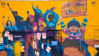 Artist restores defaced mural in Raleigh
