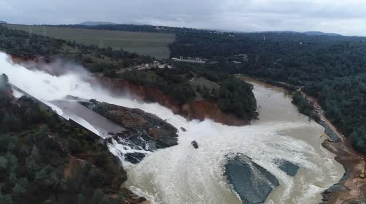 Aerial view of damage to Oroville Dam's main spillway after days of