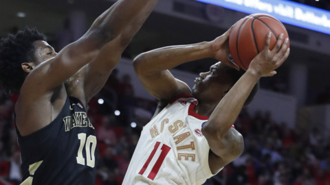 NC State and Wake Forest pass in night, headed different directions