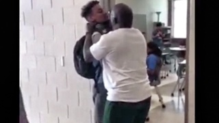 Teacher suspended after video posted showing him allegedly choking a student