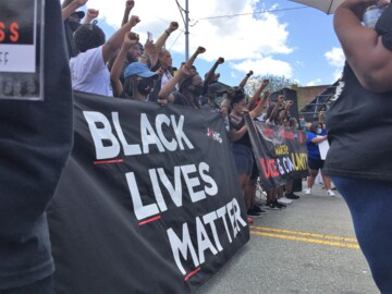 Black Lives Matter demonstrators face off against Confederate statue defenders in NC