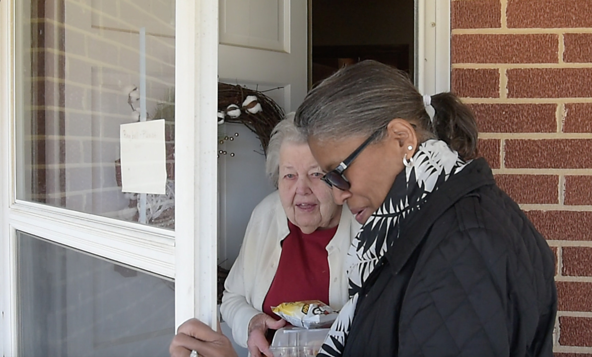 Retirees deliver meals and visit with some of the county's oldest residents