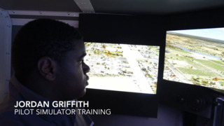 Young aviator takes a short 'flight' around RDU on simulator