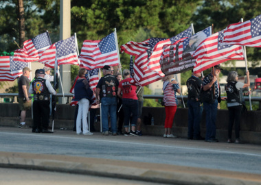 'I was there': Patriotic flag bearers gather over I-77 to remember 9-11
