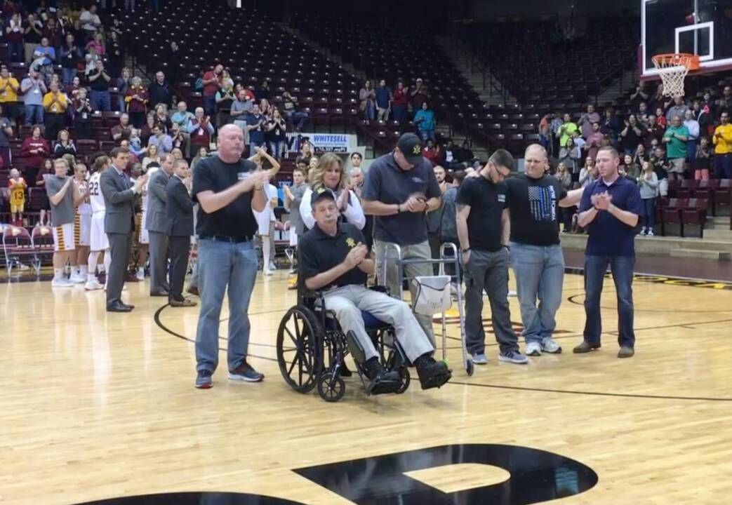 York County officers who limped, were wheeled to free throw line scored with the crowd