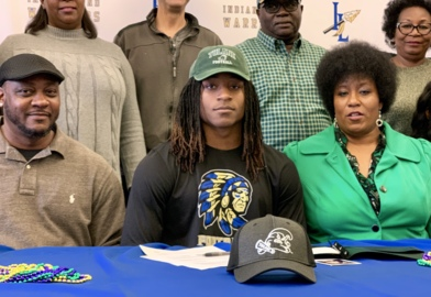 Indian Land's Dorian Williams surrounded by supporters on National Signing Day