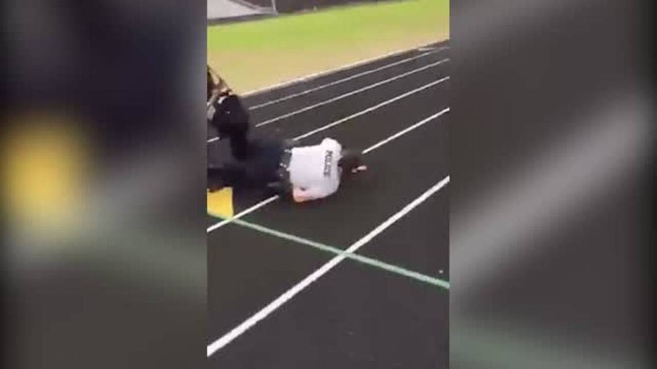 Student throws volleyball at officer on bike, and the whole world cringes