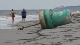 Another buoy washes up on the beach of Hilton Head, this one at the island's heel