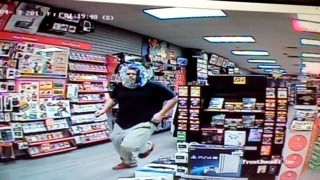 Surveillance video shows man robbing Georgia GameStop with a plastic bag on his head