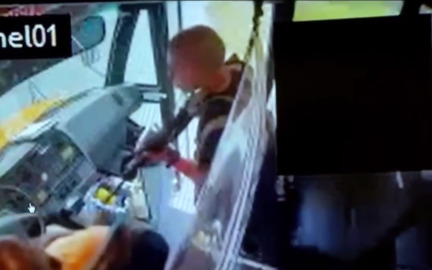 Watch a school bus driver deal with an armed soldier who hijacked a busload of children.