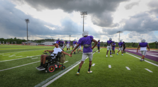 Paralyzed Westwood football player returns to the field