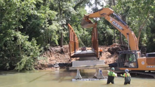 Watch as new pedestrian bridge is put into place over Three Rivers Greenway
