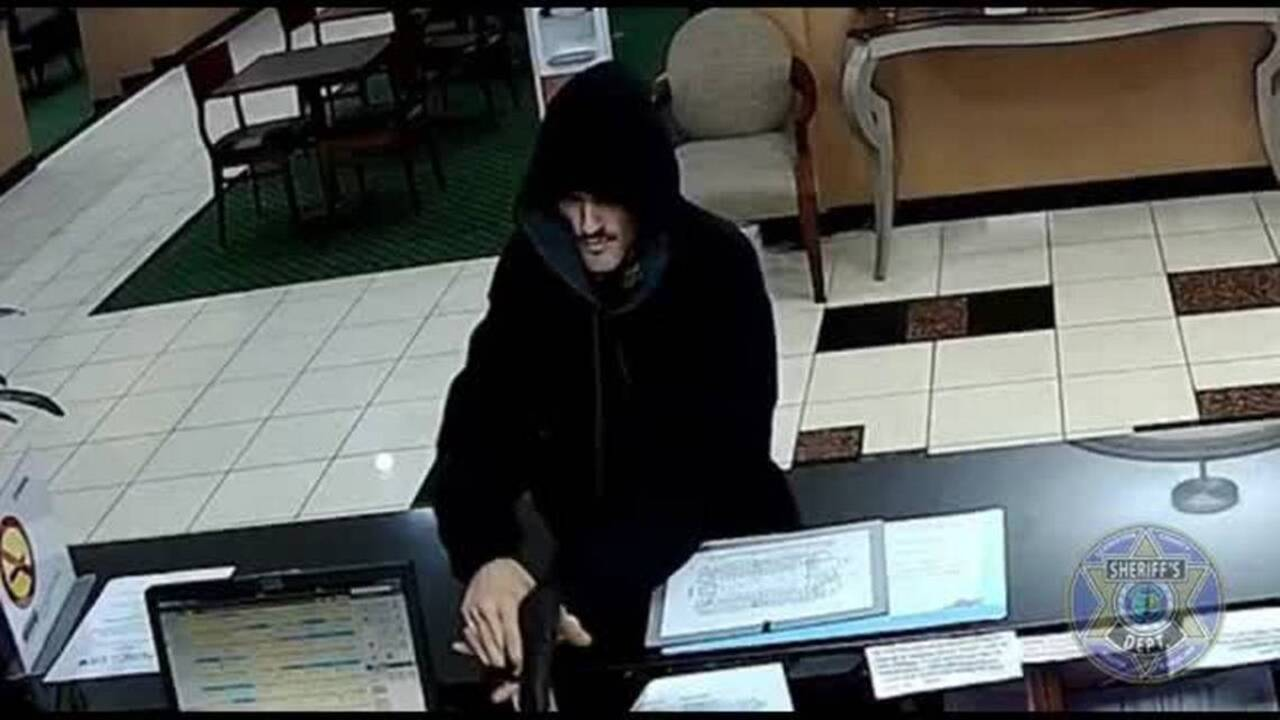 Surveillance video of armed robbery of Baymont Inn