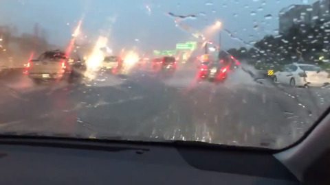 Heavy rain floods I-70 just west of St. Louis