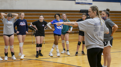 Carly Thomas a former Althoff Volleyball standout takes over as head coach