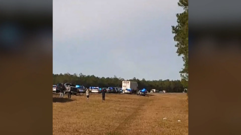 Standoff with machete-wielding truck driver started with road rage at ambulance, officials say