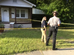 Searching for clues where woman's body found
