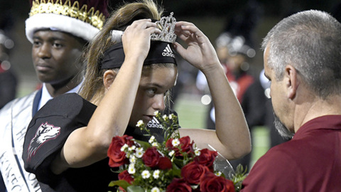 Howard kicker trades cleats and helmet for a homecoming crown
