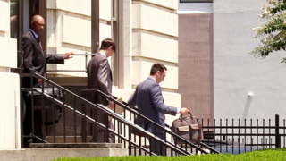 Macon businessman exits federal courthouse after opening day of testimony