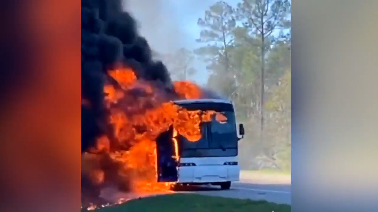 Watch as bus carrying fraternity members bursts into flames on Mississippi highway