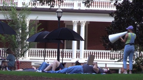 """Georgia College students, faculty hold 'die-in"""" protest on campus to criticize the college's handling of coronavirus"""
