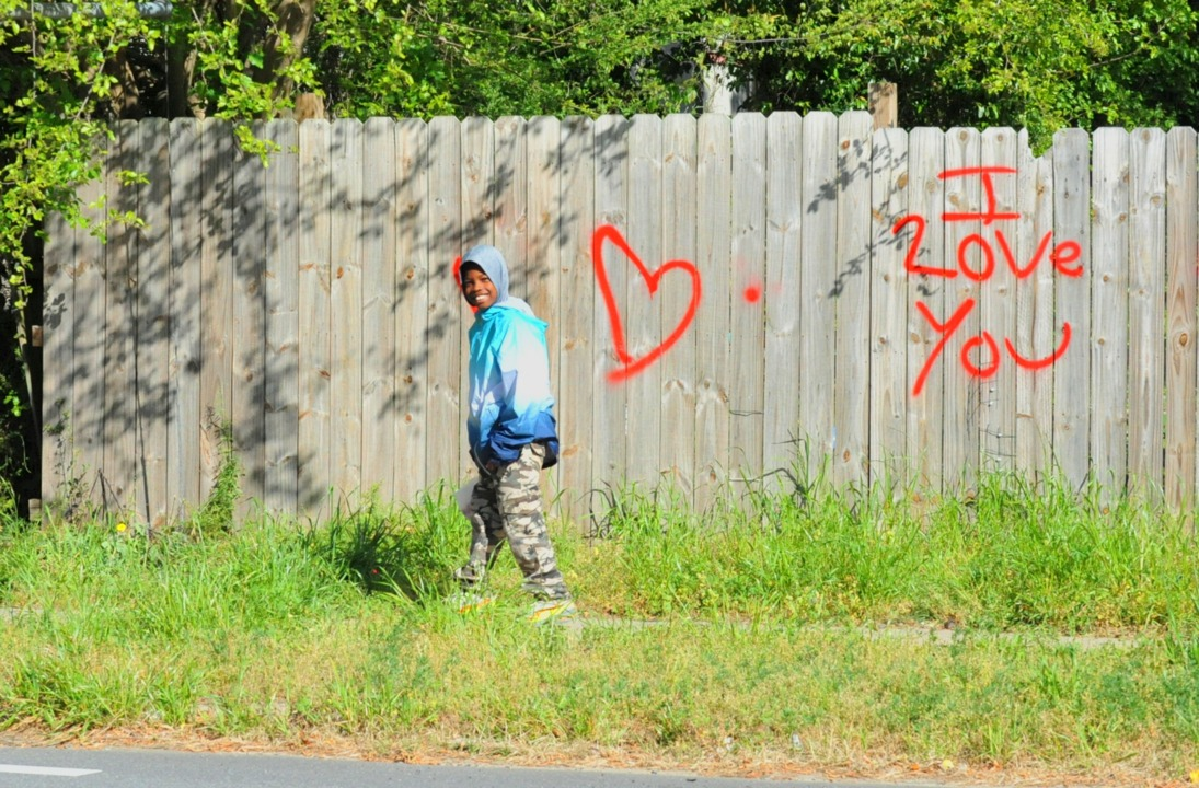 An eye-catching 'I love you' spray-painted along Macon street catches reporter's eye