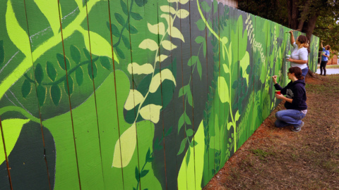 New mural in Columbus  brightens community orchard in 'The Bibb'