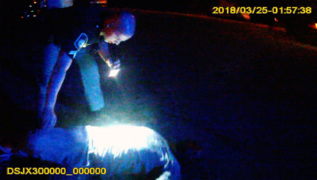 Watch as Columbus police officer rescues man from burning car