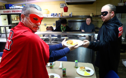"Grease Monkey ""superheroes"" provide breakfast, big check to school serving students in need"