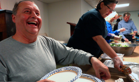"""Volunteers serve as the """"hands and feet of Jesus"""", feed homeless at SafeHouse"""