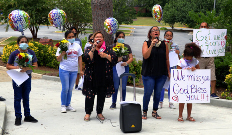 Parishioners gather to pray for, serenade friars quarantined due to COVID-19