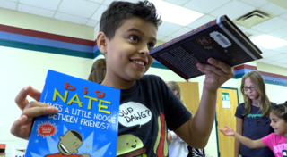 Feeding and Reading program fosters reading by offering kids a book for dessert