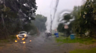 Time Lapse Video: Heavy afternoon rains inundate downtown area