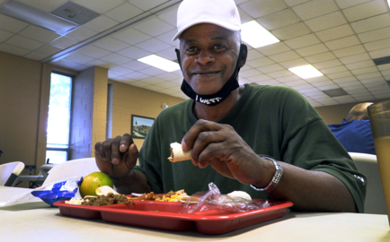 Return of in-person dining brings food, prayer, fellowship to those in need
