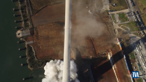 Towering smoke stack implodes and topples into Alabama field, demolition video shows