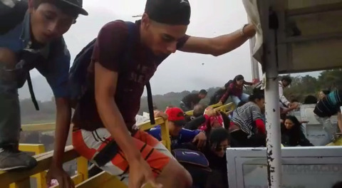 Flaring tensions, defections at the border as first shipment of aid enters Venezuela
