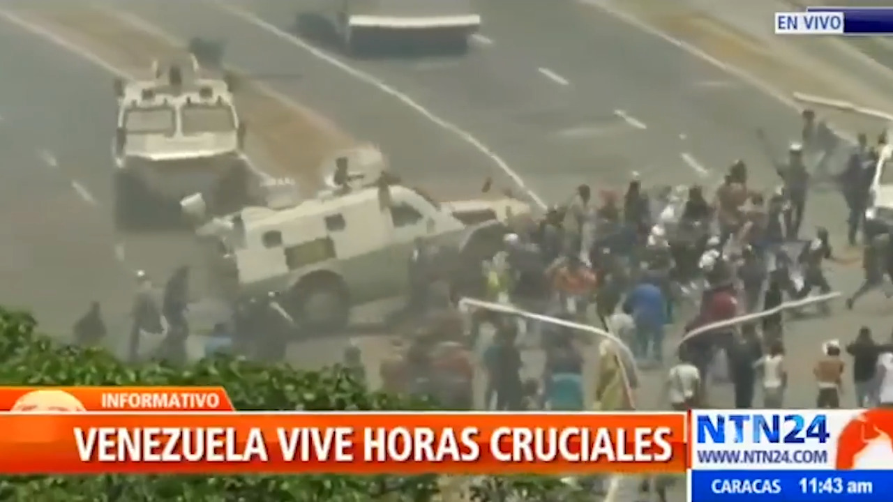 Armored vehicle runs over protesters in Venezuela (IN