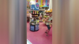 People run through a store at Broadway at the Beach