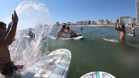 'Perfect place to make it official': Surfer couple ties the knot where it all began